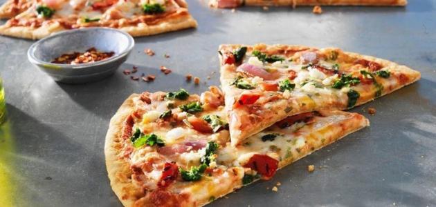 صورة كيف عمل البيتزا في البيت , بيتزا المطاعم بالمنزل